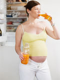 Pregnant woman with juice Royalty Free Stock Image