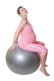Pregnant woman keeping fit. Stock Photos