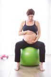 Pregnant woman keeping in shape Royalty Free Stock Image