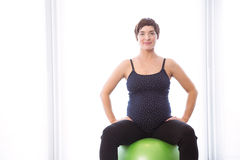 Pregnant woman keeping in shape Royalty Free Stock Photos