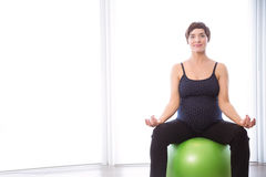 Pregnant woman keeping in shape Stock Photos