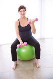 Pregnant woman keeping in shape Stock Photography