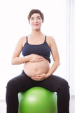 Pregnant woman keeping in shape Royalty Free Stock Photography