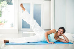 Pregnant woman keeping in shape at home Royalty Free Stock Images