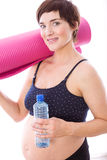 Pregnant woman keeping in shape Royalty Free Stock Photo