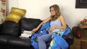 Pregnant woman kick off wrap, take book about birth  motherhood stock video footage