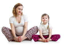 Pregnant woman with kid doing yoga exercises Royalty Free Stock Photo