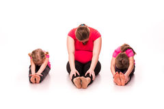 Pregnant woman with kids exercising isolated Stock Images
