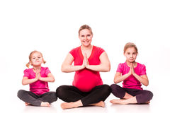 Pregnant woman with kids exercising isolated Royalty Free Stock Image
