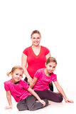 Pregnant woman with kids exercising  Royalty Free Stock Photo