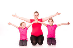 Pregnant woman with kids exercising  Stock Image