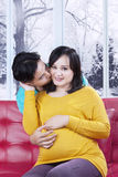 Pregnant woman kissed by her husband Royalty Free Stock Photography