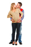 Pregnant woman kissing husband  on white Stock Photo