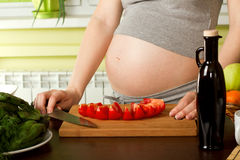 Pregnant woman on kitchen Stock Photo