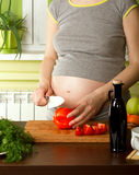 Pregnant woman on kitchen Royalty Free Stock Photography