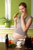 Pregnant Woman On Kitchen Royalty Free Stock Photo