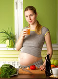 Pregnant Woman on Kitchen Royalty Free Stock Image