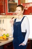 Pregnant woman in kitchen with  chocolate Royalty Free Stock Photography