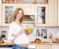 Pregnant woman in kitchen Royalty Free Stock Photo