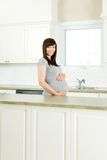 Pregnant Woman in Kitchen Royalty Free Stock Images