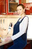 Pregnant woman in kitchen making a food Royalty Free Stock Image