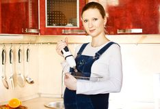 Pregnant woman in kitchen making a food Royalty Free Stock Photography