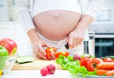 Pregnancy and cooking royalty free stock photography