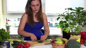 Pregnant woman in kitchen prepare fresh salad from onion and organic vegetables. Pregnant woman in the kitchen preparing fresh salad from onion and organic stock video footage