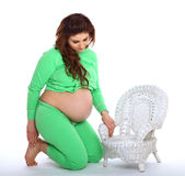Pregnant woman kneeling Royalty Free Stock Image