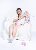 Pregnant woman knitting Stock Photography