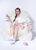 Pregnant woman knitting Royalty Free Stock Images
