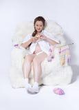 Pregnant woman knitting Stock Image