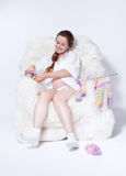 Pregnant woman knitting Stock Images