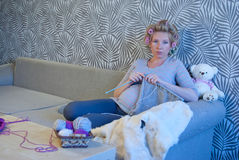 Pregnant woman knitting. For baby Royalty Free Stock Photos