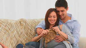 Pregnant woman knitting with her husband Royalty Free Stock Images