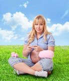 Pregnant woman knitting  for unborn child Stock Photography