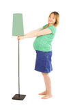 Pregnant woman and lamp Royalty Free Stock Photography