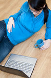 Pregnant woman and laptop Royalty Free Stock Photography