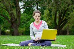 Pregnant woman with laptop Royalty Free Stock Photos