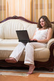 Pregnant woman with laptop Royalty Free Stock Image