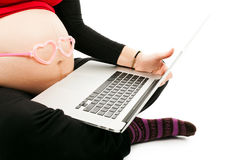 Pregnant Woman with laptop Royalty Free Stock Photography