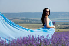 Pregnant woman in lavender Stock Image