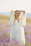 Pregnant woman in a lavender field Stock Photo