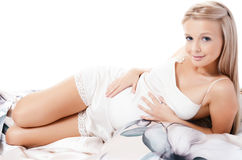 The pregnant woman lays Royalty Free Stock Images