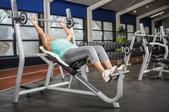 Pregnant woman lifting barbell Royalty Free Stock Photography