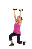 Pregnant woman lifting weights Royalty Free Stock Photography