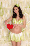 Pregnant woman in lingerie from cabbage and heart Stock Images