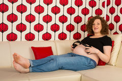 Pregnant woman listening musci Royalty Free Stock Photo