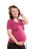 Pregnant Woman Listening To The Music Stock Photography