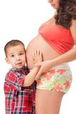 Pregnant woman and a little boy Royalty Free Stock Image